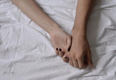 Holding hand in bed
